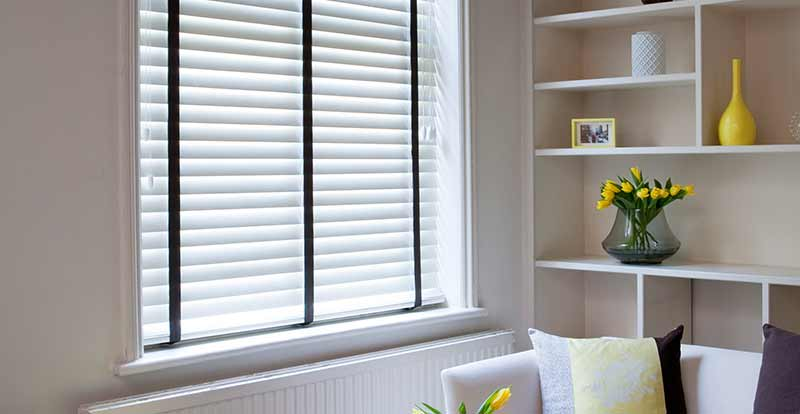 White wood blinds with black tapes