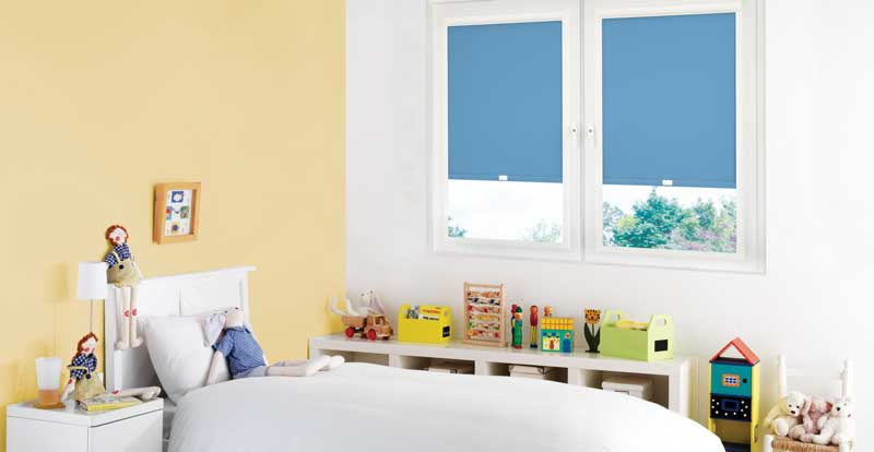 Blue perfect fit blind in a children's room