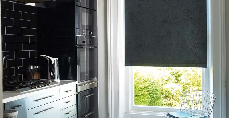 Blackout grey roller blind in a kitchen