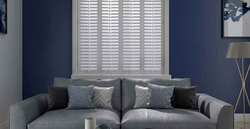 White real wood full height shutters in a living room